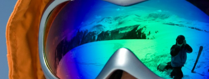 Ski goggles reflecting snow